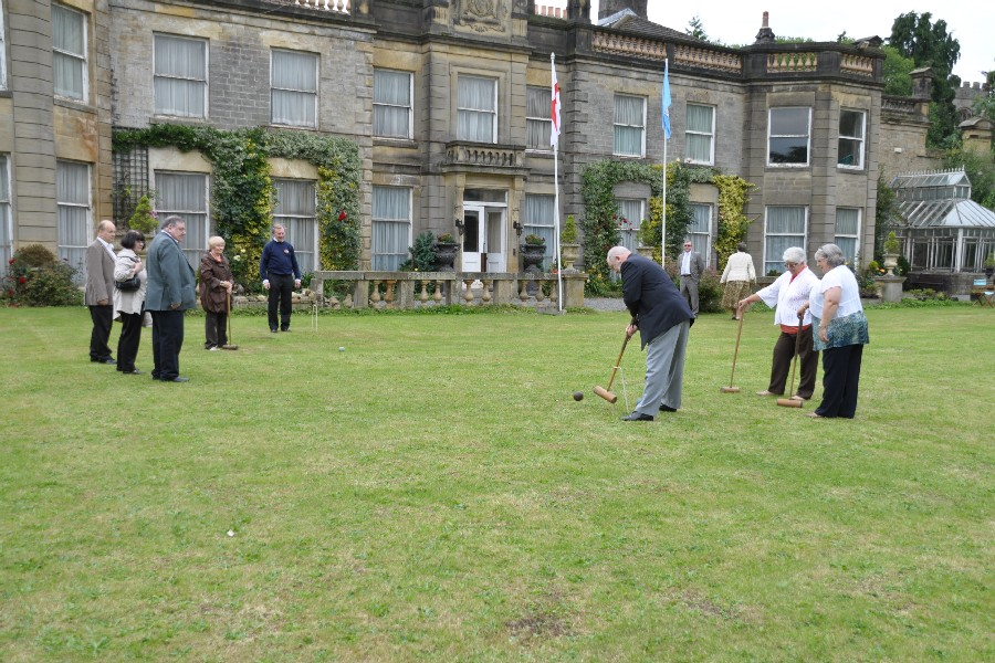 a game of croquet on the lawn